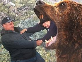 Robert-and-Martha-Avey-with-bear-280x211